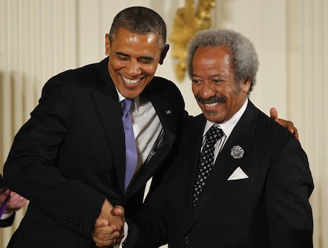 President Barack Obama greets composer, producer, and performer Allen Toussaint