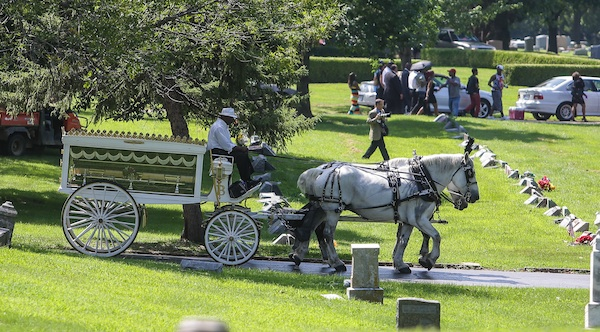 Casket taken to cemetary in a horse-drawn carriage, symbolizing royalty. PHOTO: Lawrence Bryant/St. Louis American